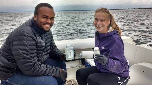 Chesapeake Conservation Corps members collect water samples as part of their work with organizations and communities in the Chesapeake Bay region. (cbtrust.org)