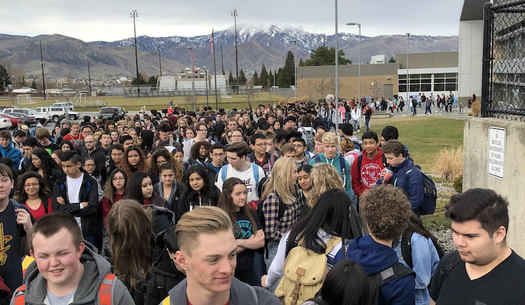 Students walk out of Eastmont High School in Wenatchee on the one-month anniversary of the Parkland, Fla., shooting. (Elli Delzer)