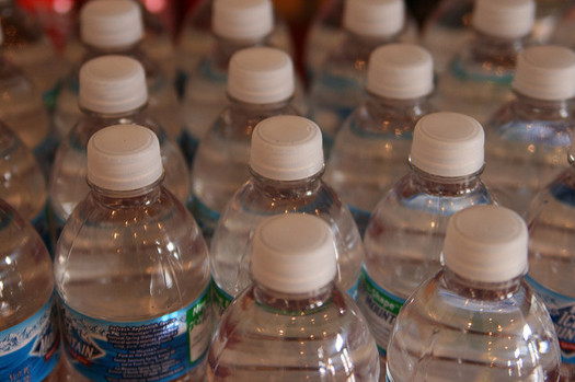 A new report says the amount of plastic used to produce bottled water in 2016 would fill the Empire State Building 1.3 times. (Quinn Dombrowski/Flickr)