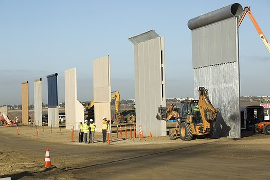 """President Donald Trump predicted """"bedlam"""" if the United States doesn't build a border wall as he visited prototypes near San Diego on Tuesday. (Mani Albrecht/Wikimedia Commons)"""