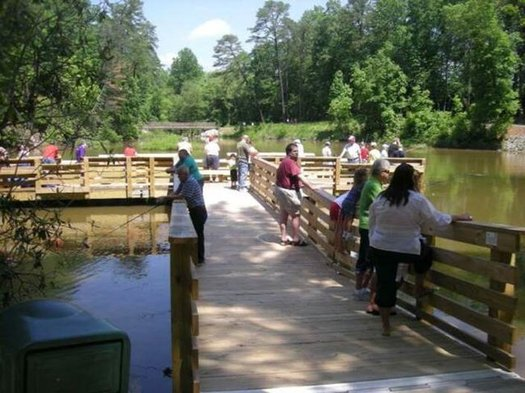 People enjoy access at Tumbling Rock Reservoir in Mount Airy, where they are able to fish and enjoy other activities, regardless of their level of mobility. (City of Mt. Airy)