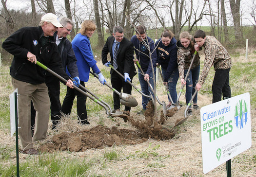 State and federal officials and local high school students joined Chesapeake Bay Foundation president Will Baker in planting the first tree. (B.J. Small/CBF Staff)