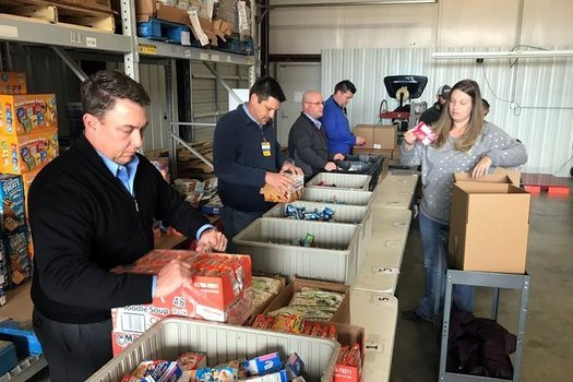 Volunteers help sort products at the Northwest Arkansas Food Bank in the Fayetteville area, one of four regional food banks in the state. (NWArkansasFoodBank)