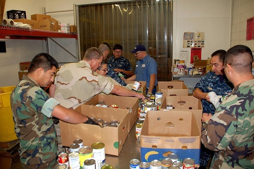 Military and civilian volunteers help sort and distribute food at the West Texas Food Bank in El Paso, one of 21 regional food banks across the state. (WikimediaCommons)
