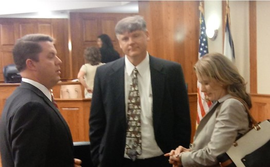 At a court hearing in Charleston last week, the judge ruled that GOP House of Delegates candidate Tally Reed, right, could stay on the ballot. (Dan Heyman)
