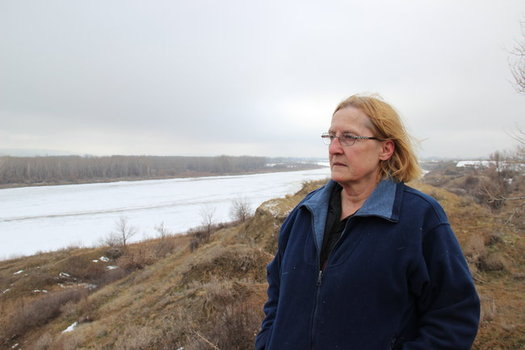 Farmer Dena Hoff, who opposes the Keystone XL project, surveys the Yellowstone River from her property, which was negatively affected by a ruptured pipeline in 2015. (Northern Plains Resource Council)