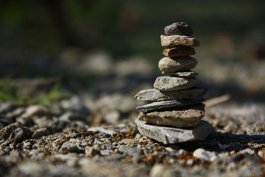 Rock piles, also known as cairns, are becoming popular things to build for hikers, but stacking rocks can damage the habitat for native animals and plants. (bulbocode909/flickr)