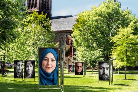 "The exhibit, ""We Are: A Nation of Immigrants,"" will be on the New Haven Green through mid-August. (Joe Standart)"