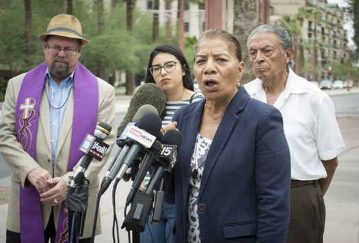 Petra Falcon gathered with community members and religious leaders Friday in front of the Immigration and Customs Enforcement Office in Phoenix to speak out against the separation of migrant children from their families. (Katherine Davis-Young/PNS)