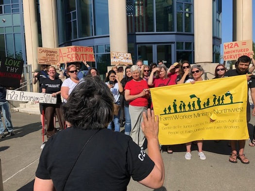 Farm workers' advocates protested Tuesday outside a court hearing about the fine for Sarbanand Farms in Sumas, Wash. (Carla Shafer)