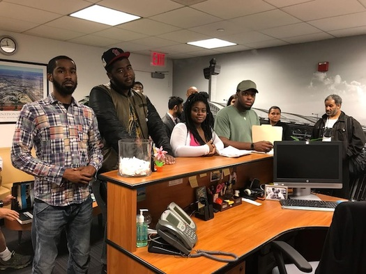 A delegation of workers delivers letters outlining their complaints to JFK International Air Terminal, which operates Terminal 4. (32BJ SEIU)
