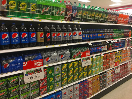 Big soda companies have pumped about $6 million so far into a Washington measure to ban future grocery taxes. (Mike Mozart/Flickr)