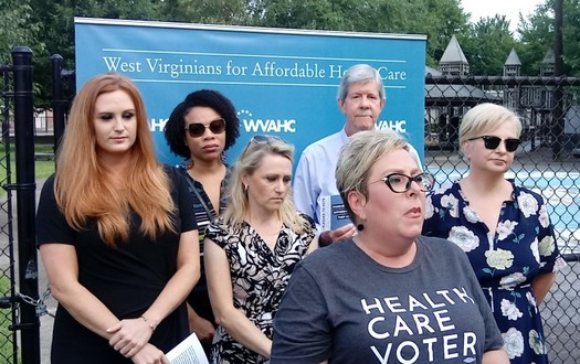 Julie Warden of Charleston, far left, spoke at a press conference supporting the Affordable Care Act last week. (Dan Heyman)