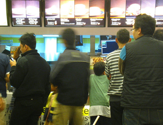 Fast food workers are among those asking for an increase in wages. (Ikhlasul Amal/flickr)