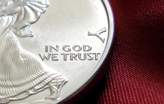"""In God We Trust"" has been considered the national motto since 1956. (Kevin Dooley/Flickr)"