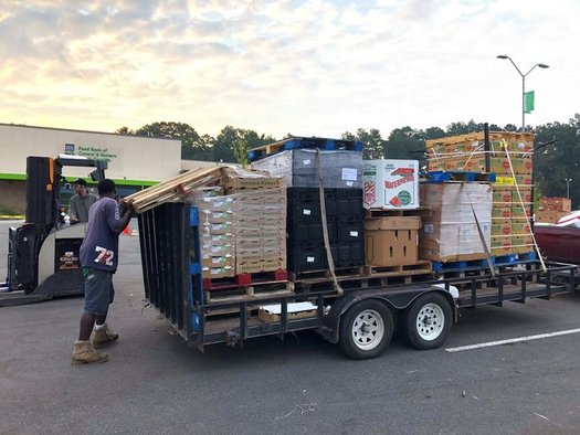 The community group Jesus House of Prayer takes a load of Florence Disaster Relief supplies to Johnston County. (Whichard/Food Bank of Central & Eastern North Carolina)
