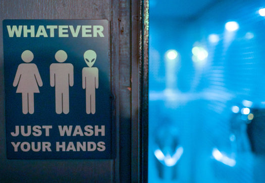 The passage of House Bill 2 and subsequent HB 142 prompted many private businesses to put up gender-neutral restroom signs in North Carolina. (Ted Eytan/Flickr)