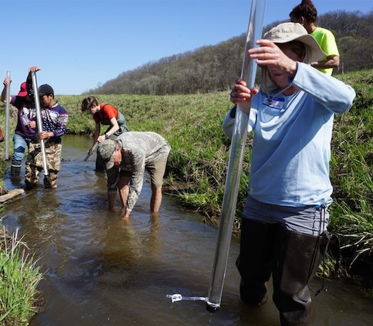 Local residents measure the turbidity of Lowery Creek on the Cates Family Farm. (Margaret Krome/Michael Fields Agricultural Institute)