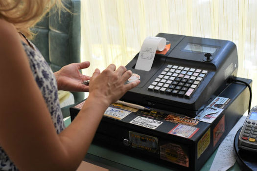 The Institute on Taxation and Economic Policy finds low-income people are spending a large portion of their incomes at the cash register in the form of sales tax. (Arsen Ametov/Twenty20)