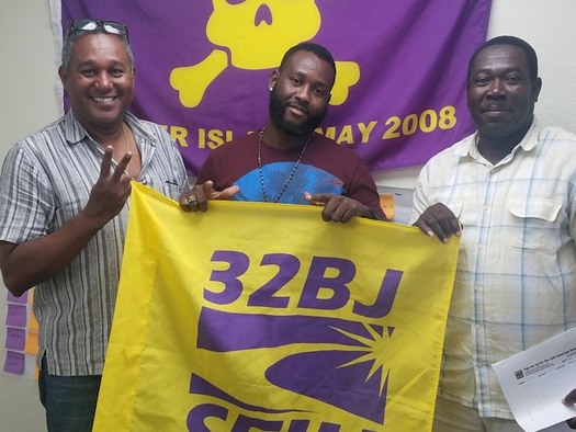 Luc Bastien, left, stands with union brothers at 32BJ SEIU after canvassing. (32BJ SEIU)