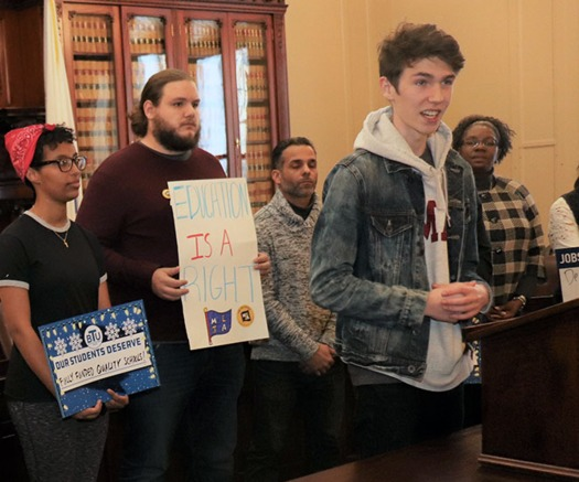 UMass Amherst Student Government Association President Timmy Sullivan speaks at the Fund Our Future Campaign rally at the Massachusetts Statehouse. (Massachusetts Teachers Assn.)