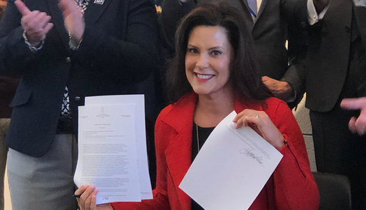 Gov. Gretchen Whitmer displays the LGBTQ anti-discrimination executive directive after a signing ceremony on Monday. (Jim Murray/Equality MI)