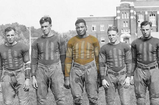 "John G. ""Jack"" Trice, center, was the first African-American athlete for Iowa State College during a time when integration was often met with racial discrimination. (Photo courtesy ISU Special Collections)"