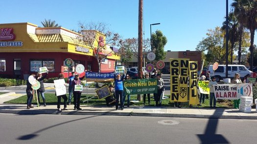 "Picketers in San Diego campaigned for the Green New Deal near the office of Rep. Duncan Hunter. (Raghavan ""Jay"" Jayakumar/San Diego 350)"