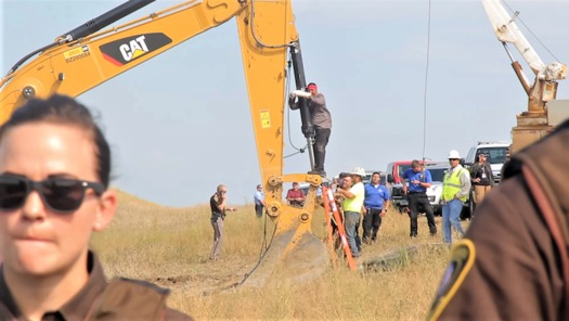 A Lakota man locks himself to construction equipment in 2016 to protest construction of the Dakota Access Pipeline. (en.wikipedia.org)