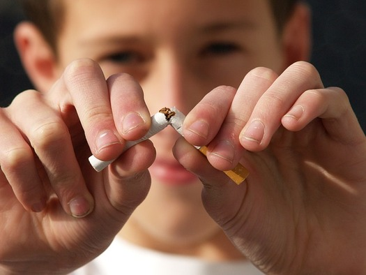 Experts say a majority of adult smokers picked up the habit before age 21. (Hans Martin Paul/Pixabay)