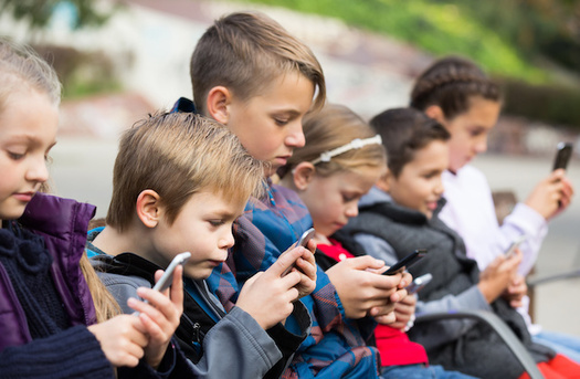 The American Academy of Pediatrics recommends school-age children have no more than two hours of screen time a day. (JackF/Adobe Stock)