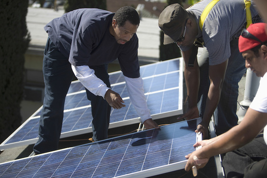 Proponents of clean energy say training workers to install solar power could help the climate and create jobs in areas hardest hit by pollution. (biker3/Adobe Stock)