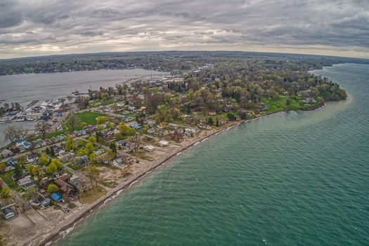 Extreme weather due to climate change can exacerbate pollution runoff and toxic algal blooms in the Great Lakes. (Jacob/Adobe Stock)