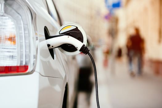 Electrifying passenger vehicles and buses will improve air quality and reduce operating costs for vehicle owners and taxpayers. (baranq/Adobe Stock)