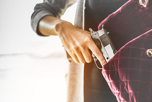 Ohio legislators are considering a bill that would make it easier for anyone age 21 or older to carry concealed weapons. (Adobe Stock)