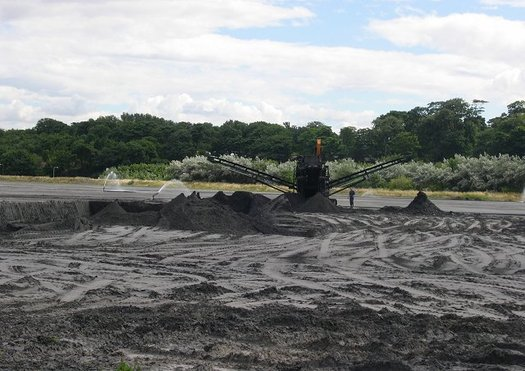 Coal ash is what's left after burning coal for electricity production, and is typically stored in open air, often unlined slurries. (Richard Webb)