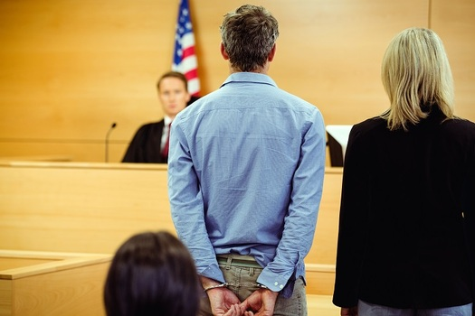 The ACLU of Arizona is challenging a law that requires defendants in some cases to either pay hefty fees for GPS monitors or await their trial date in jail. (wavebreakmedia/Adobe Stock)