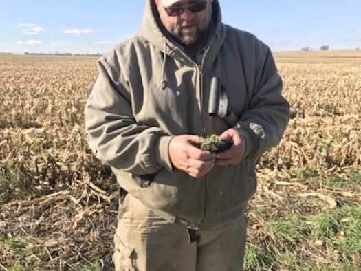 Adopting no-till farming practices to improve soil texture and structure has helped Iowa farmer Loran Steinlage adapt to weather extremes. (landstewardshipproject.org)