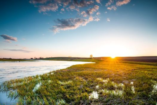 River flooding is common on the plains of Minnesota, where many communities are seeing heavier rain and more flood-related issues to prepare for. (Mitch/Adobe Stock)