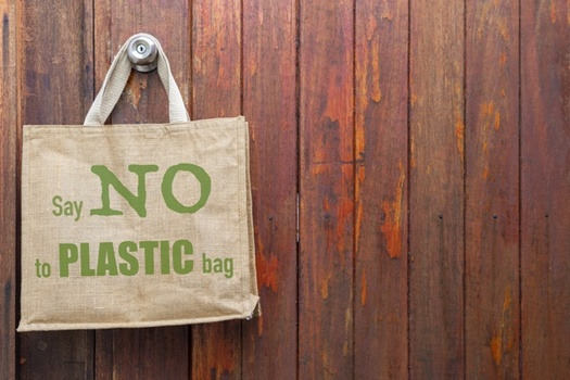 Several Ohio communities have ordinances banning or imposing a tax on the use of single-use plastic bags and containers. (AdobeStock)