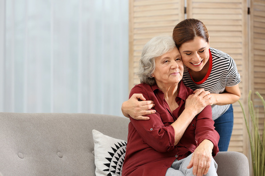 In a survey, nearly half of Oregonians age 40 and older say they are a current or former family caregiver. (New Africa/Adobe Stock)