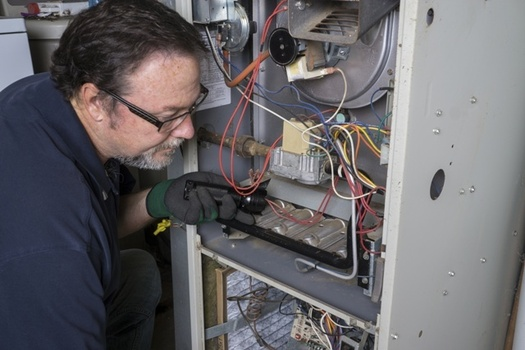 Weatherization crews in Ohio use energy audits and diagnostic equipment to identify ways to improve a home's energy use. (AdobeStock)