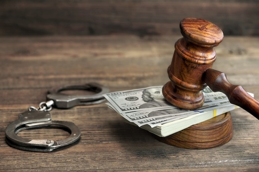 Civil rights groups are challenging the judicial system's use of cash bail in Alamance County. (Adobe Stock)