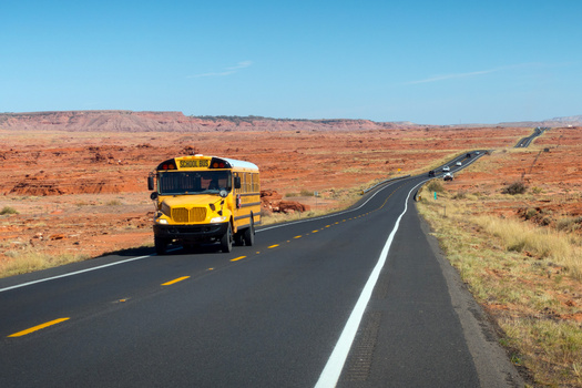 A school bus transports students through the Navajo Nation on U.S. Highway 89 in northern Arizona. Bus routes in rural school districts often cover more than 100 miles a day picking up and dropping off students. (Savola/Adobe Stock)