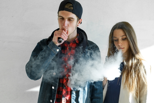Children and young people are being bombarded with tobacco industry marketing for flavored e-cigarettes. (Adobe stock)