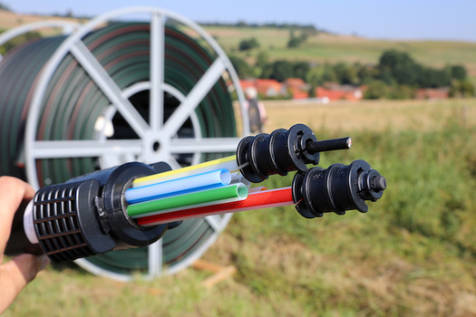 Fiber-optic technologies have increased internet speeds and are projected to play a critical role in the telecommunications industry in the next few decades. (Adobe Stock)