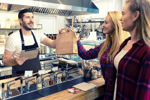 Most Arizona hourly workers, including food service, hospitality and retail employees, received a pay raise on Jan. 1, 2020, under the state's minimum wage law. (rentea/Adobe Stock)