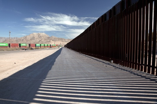 The U.S. Supreme Court will decide whether to review lower court rulings that allow the Trump administration to waive environmental laws for border-wall construction, including a 180-mile stretch in New Mexico. (ArtueoM/Adobe Stock)