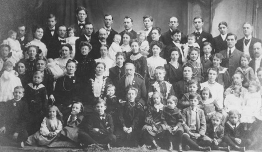 Joseph F. Smith (center), an early leader of the Church of Jesus Christ of Latter-Day Saints, is shown in 1904 with his polygamous family, including his sons and daughters, their spouses and children. (Wikimedia Commons)