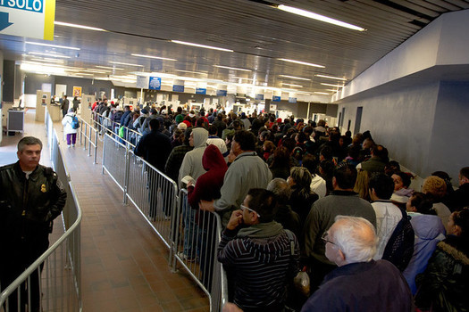 Migrants and others often face long lines and other delays at the U.S.-Mexico border in their quest to gain asylum in the United States. (JDenmark/Flickr)